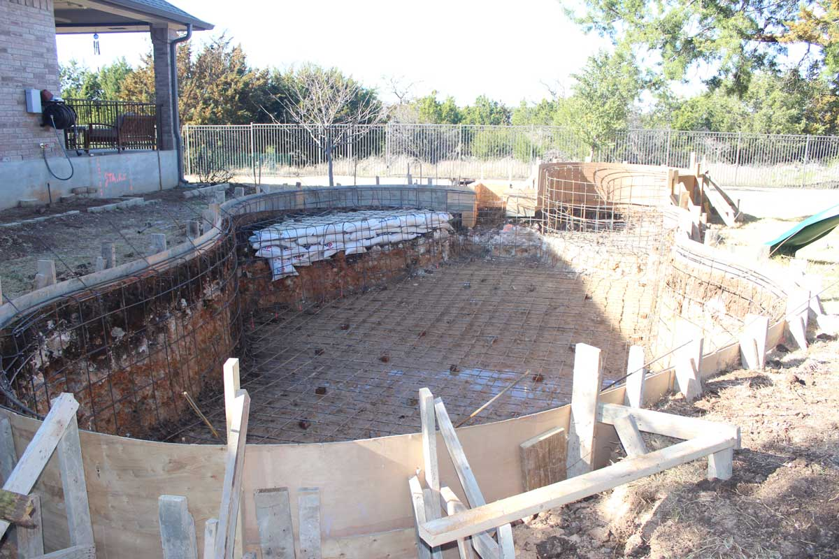 Construction cyrstal springs custom pools for Swimming pool rebar requirements